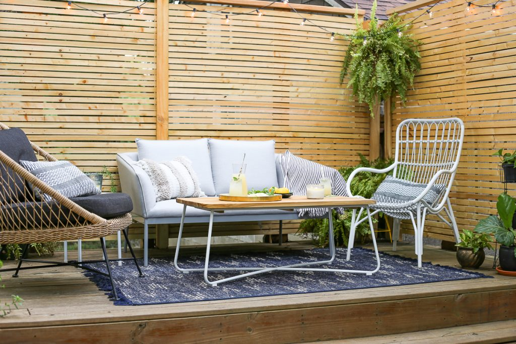 Kansas City patio with slatted-wood privacy screen and modern outdoor furniture from Article.